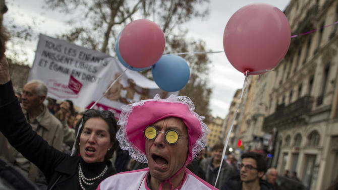 Demonstrators protest against French President Francois Hollande's plan to legalize marriage and adoption for gay people, in Lyon, central France, Saturday, Nov. 17, 2012. (AP Photo/Laurent Cipriani)