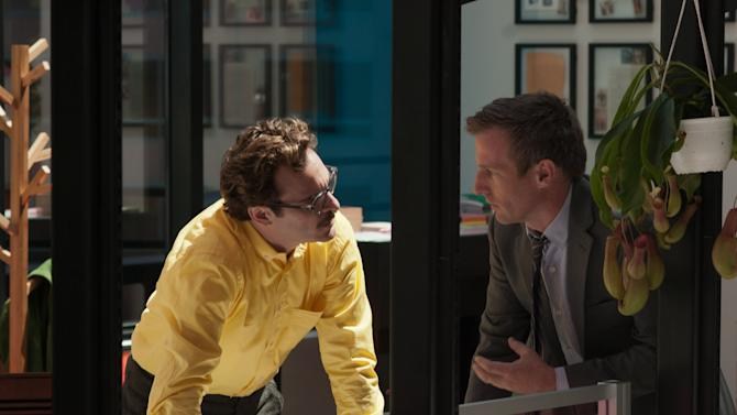 """This image released by Warner Bros. Pictures shows Joaquin Phoenix, left, and director Spike Jonze on the set of """"Her."""" The film has been selected as the best film of the year by the National Board of Review and Phoenix was nominated for a Golden Globe for best actor in a motion picture musical or comedy. (AP Photo/Warner Bros. Pictures, Merrick Morton)"""