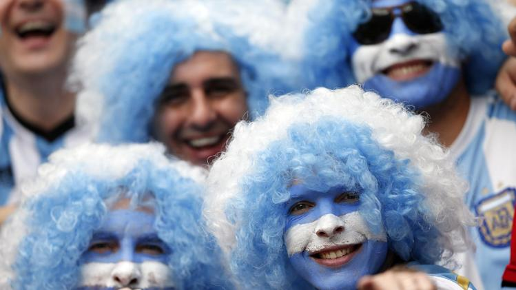 Argentina fans smile prior to the group F World Cup soccer match between Nigeria and Argentina at the Estadio Beira-Rio in Porto Alegre, Brazil, Wednesday, June 25, 2014