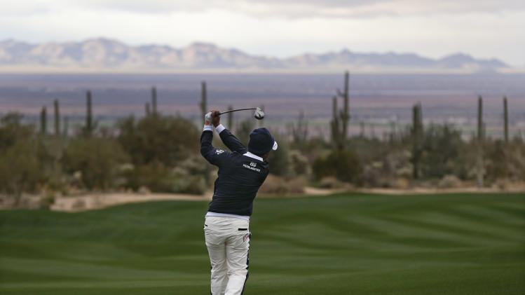 Japan's Hiroyuki Fujita hits an approach shot on the second fairway while playing against Matt Kuchar in the first round during the Match Play Championship golf tournament, Wednesday, Feb. 20, 2013, in Marana, Ariz. (AP Photo/Julie Jacobson)