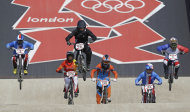 New Zealand's Sarah Walker (96) leads the competition during a BMX cycling women's semifinal run at the 2012 Summer Olympics, Friday, Aug. 10, 2012, in London. (AP Photo/Sergey Ponomarev)