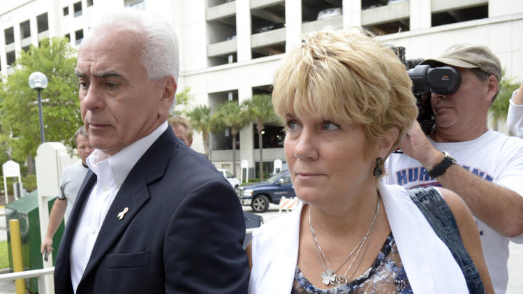 George Anthony, left, and Cindy Anthony, parents of Casey Anthony, arrive at the Orange County Courthouse for Casey Anthony's sentencing in Orlando, Fla., Thursday, July 7, 2011.  Anthony was acquitted of murder charges.  (AP Photo/Phelan M. Ebenhack)