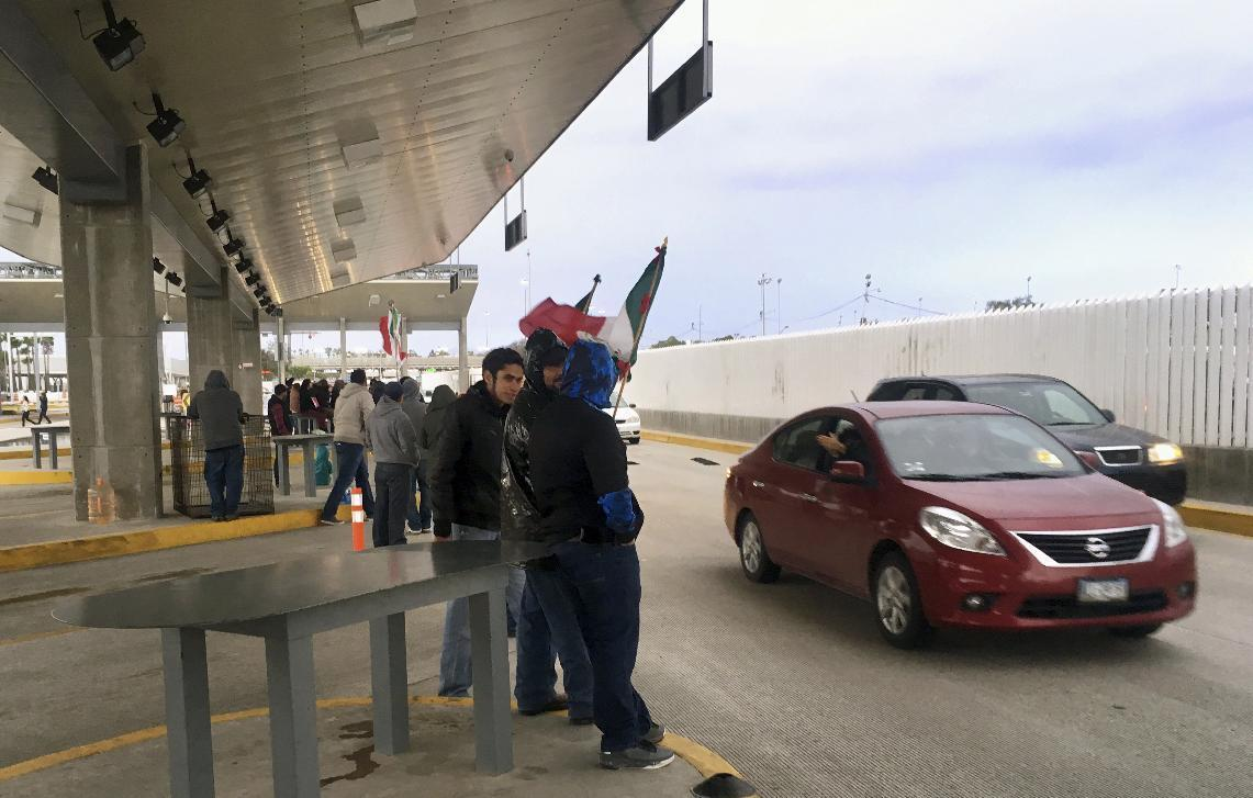 Protesters take control of Mexican border crossing with US