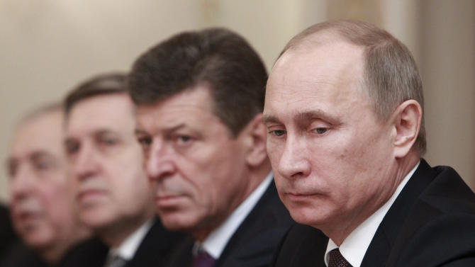 Members of a Russian delegation, led by President Vladimir Putin, right, meet with colleagues from a Finnish delegation, led by President Sauli Niinisto, not pictured at the Novo-Ogaryovo state residence outside Moscow, Tuesday, Feb. 12, 2013. (AP Photo/ Sergei Karpukhin, pool)