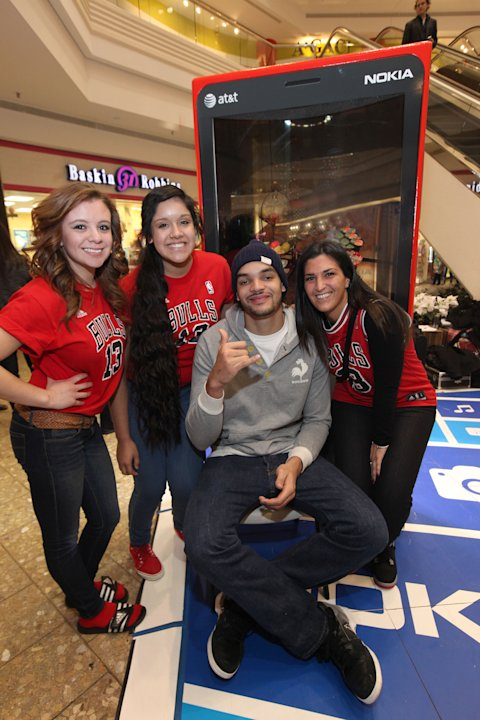 IMAGE DISTRIBUTED FOR NOKIA - Chicago Bulls center Joakim Noah, second from right, greets his fans with his new Nokia Lumia 920 at the Nokia Experience Center, during the Joakim Noah Nokia Mall Tour,