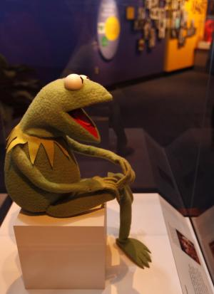 """A Kermit the Frog puppet is seen on display as part of a new exhibit,  """"American Stories,"""" at the Smithsonian National Museum of American History in Washington, Wednesday, April 11, 2012. The National Museum of American History will open a new exhibit featuring iconic objects from pop culture along with objects dating back to the Pilgrims' arrival in 1620. """"American Stories"""" will be a new chronology of U.S. history from the first encounters of Europeans and Native Americans to the 2008 presidential election. (AP Photo/Jacquelyn Martin)"""