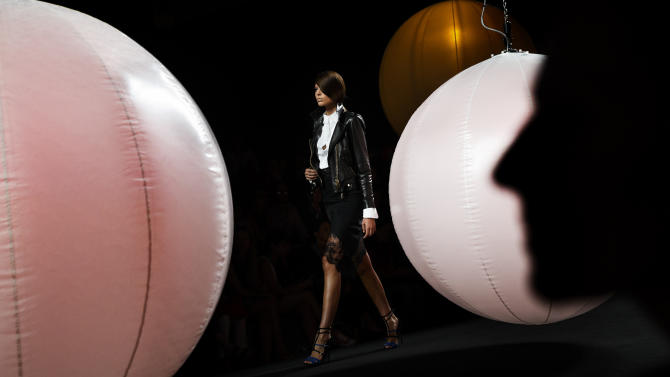 A model displays a Autumn/Winter design by Andres Sarda during the young designers show at Madrid's Fashion Week in Madrid, Spain, Monday, Sept. 15, 2014. (AP Photo/Daniel Ochoa de Olza)