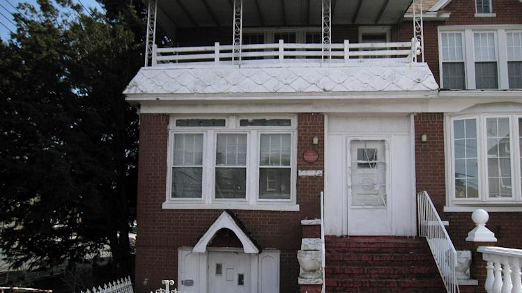 "This April 7, 2013 image shows a house in the Brooklyn borough of New York where baseball great Jackie Robinson once lived. A plaque on the door says: ""The first African-American major league baseball player lived here from 1947 to 1949."" A new movie, ""42,"" tells Robinson's inspiring story as the man who integrated Major League Baseball. The house at 5224 Tilden Ave. in East Flatbush is one of a number of places in Brooklyn connected to Robinson. (AP Photo/Beth J. Harpaz)"
