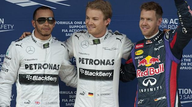 Mercedes' British driver Lewis Hamilton, Mercedes' German driver Nico Rosberg and Red Bull Racing's German driver Sebastian Vettel celebrate in the parc ferme after the qualifying session at the Circuit de Catalunya in Barcelona on May 11 (AFP)