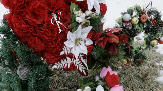 In this Feb. 22, 2008 file photo, flowers and a small angel statue surround the grave marker of Kathleen Savio, the third wife of former Bolingbrook, Ill., police officer Drew Peterson, at the Queen of Heaven Cemetery in Hillside, Ill. Originally ruled an accident, her death was later changed to a homicide. Peterson was charged with her murder in May 2009. Jury selection in his trial begins Monday, July 23, 2012, at the Will County Courthouse in Joliet, Ill. (AP Photo/Charles Rex Arbogast, File)