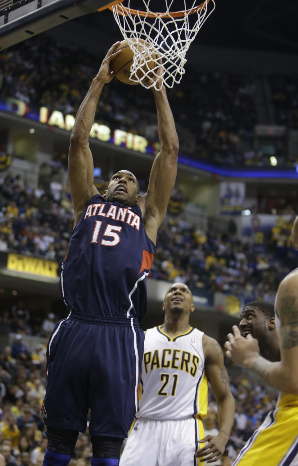 Atlanta Hawks' Al Horford (15) shoots against Indiana Pacers' David West during the first half of Game 1 in the first round of the NBA basketball playoffs on Sunday, April 21, 2013, in Indianapolis. (AP Photo/Darron Cummings)