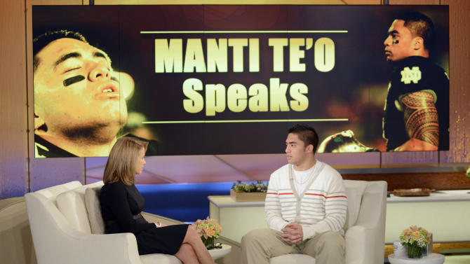 """In this photo taken on Jan. 22, 2013 and released by ABC Notre Dame linebacker Manti Te'o, right, speaking with host Katie Couric during an interview for """"Katie,"""" in New York. Te'o has told Couric that he briefly lied about his online girlfriend after discovering she didn't exist, while maintaining that he had no part in creating the hoax. The interview will air on Thursday, Jan. 24.  (AP Photo/Disney-ABC, Lorenzo Bevilaqua)"""
