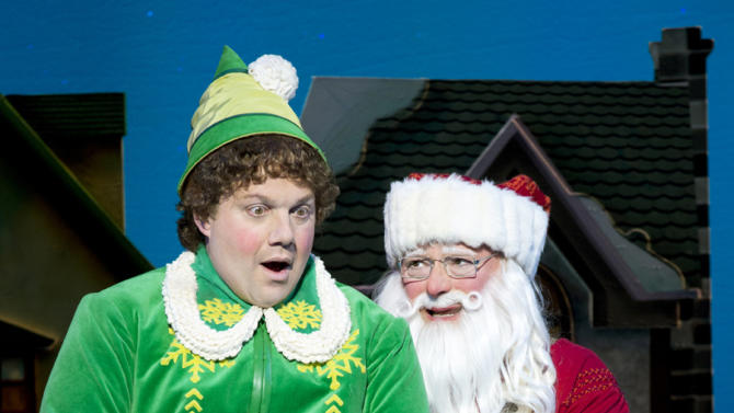 """This undated publicity photo provided by The Hartman Group shows Wayne Knight, right, as Santa and Jordan Gelber as Buddy, in a scene from """"Elf"""" at the Al Hirschfeld Theatre in New York. (AP Photo/The Hartman Group, Joan Marcus)"""