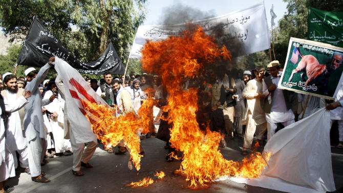 "Afghan university students burn a U.S. flag  in Surkhrod  district of Nangarhar province, east of Kabul, Afghanistan, Wednesday, Sept 19, 2012. Hundreds of Afghans, some shouting ""Death to America"",   held a protest against an anti-Islam film in the eastern city of Jalalabad. (AP Photo/Rahmat Gul)"