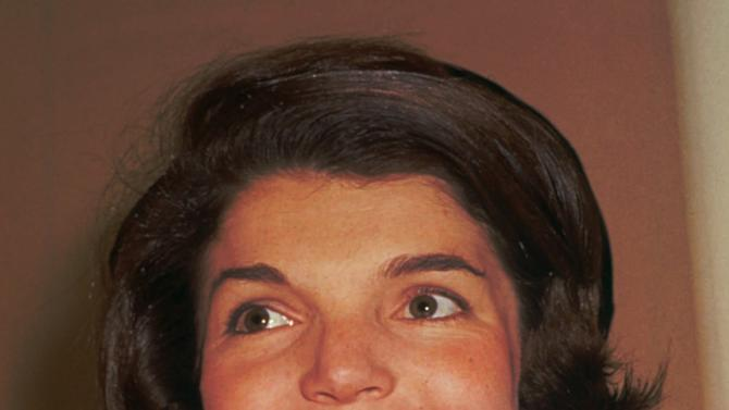 FILE - This 1961 file photo shows Jacqueline Bouvier Kennedy, wife of President John F. Kennedy. A special summer exhibit on Jackie Kennedy's life on Cape Cod has opened at the John F. Kennedy Hyannis Museum. The exhibit includes photos, handwritten letters and other artifacts from her time on the Cape. The curator said the exhibit captures Kennedy enjoying carefree days with her family, a different glimpse of a woman who was an international sensation. (AP Photo/File)