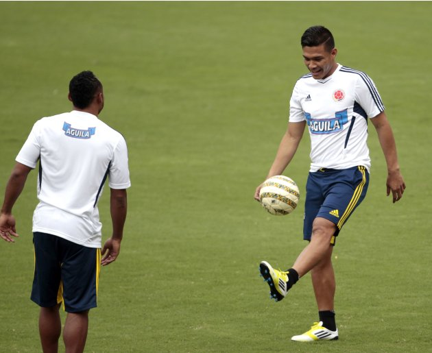 Colombia's Teofilo Gutierrez and Zuniga play with the ball during a practice session in Barranquilla
