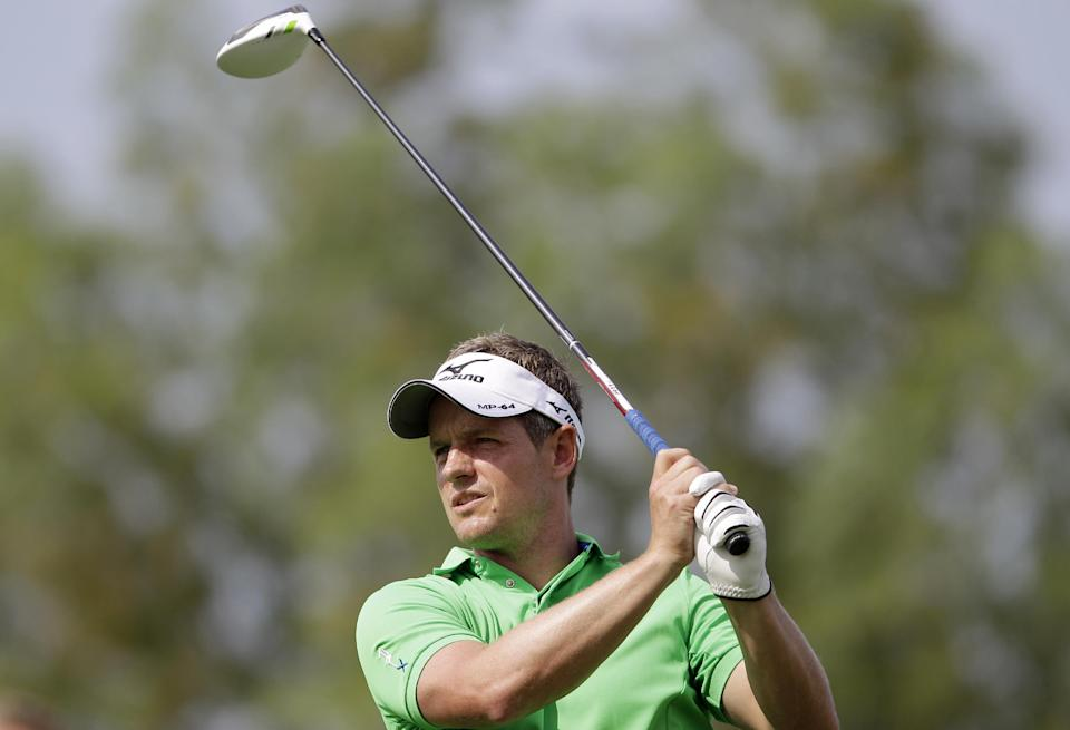 Luke Donald of England eyes his tee shot on the 2nd hole during the round one of DP World Golf Championship in Dubai, United Arab Emirates, Thursday, Nov. 22, 2012. (AP Photo/Kamran Jebreili)