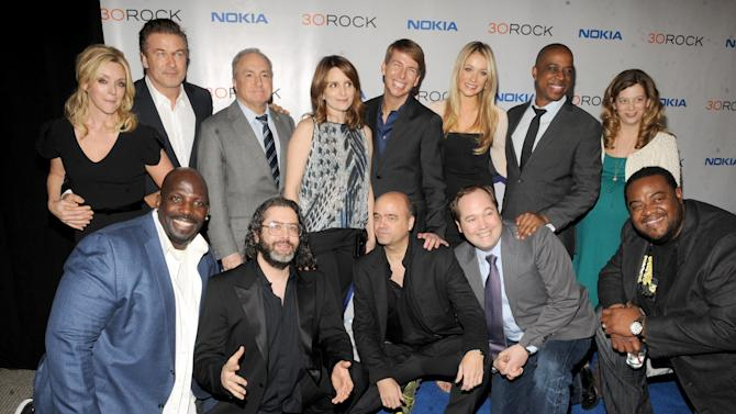 "IMAGE DISTRIBUTED FOR NOKIA - The cast of ""30 Rock"" back row, from left, Jane Krakowski, Alec Baldwin, Lorne Michaels, Tina Fey, Jack McBrayer, Katrina Bowden,Keith Powell, Sue Galloway and front row, from left, Kevin Brown, Judah Friedlander, Scott Adsit, John Lutz and Grizz Chapman attend the Nokia ""30 Rock"" wrap party on Thursday, Dec. 20, 2012, in New York. (Photo by Scott Gries for Nokia/AP Images)"