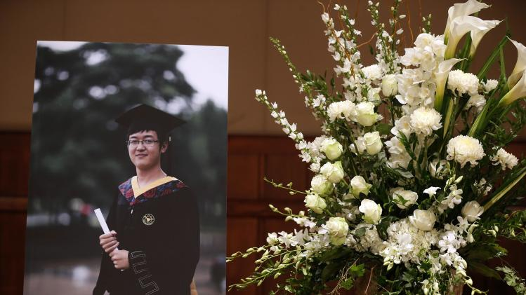 A photo of murdered USC graduate student Ji Xinran is seen at his memorial service on the USC campus in Los Angeles