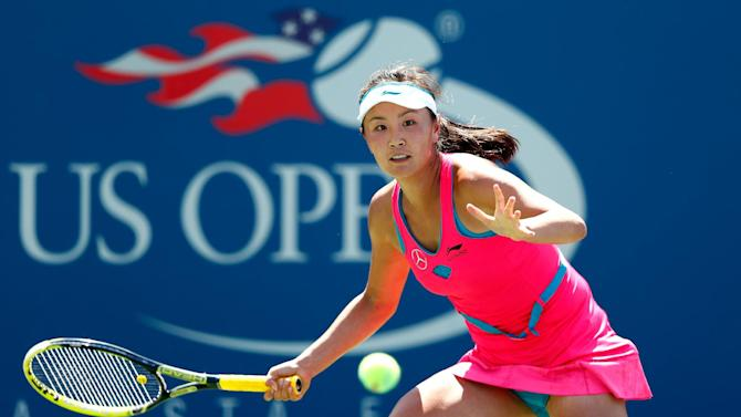 Shuai Peng of China returns a shot against Agnieszka Radwanska of Poland during their US Open women's singles match, at the USTA Billie Jean King National Tennis Center in New York, on August 27, 2014