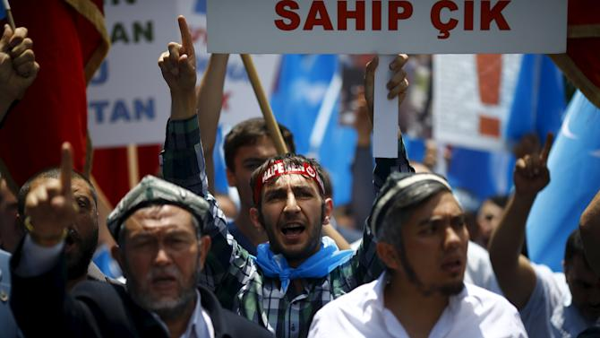 Demonstrators shout slogans during a protest against China near the Chinese Consulate in Istanbul