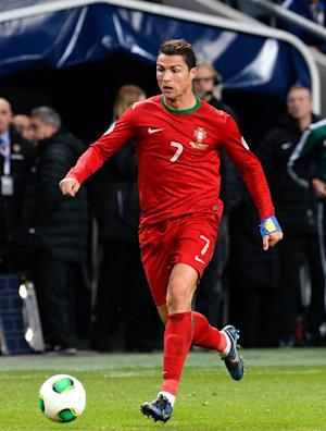 Cristiano Ronaldo runs with the ball during the …