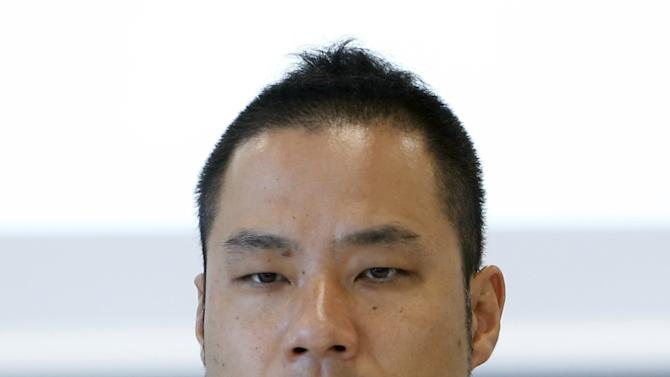 Kenjiro Sano, designer of the Tokyo 2020 Olympic and Paralympic Games logos, speaks during a news conference in Tokyo