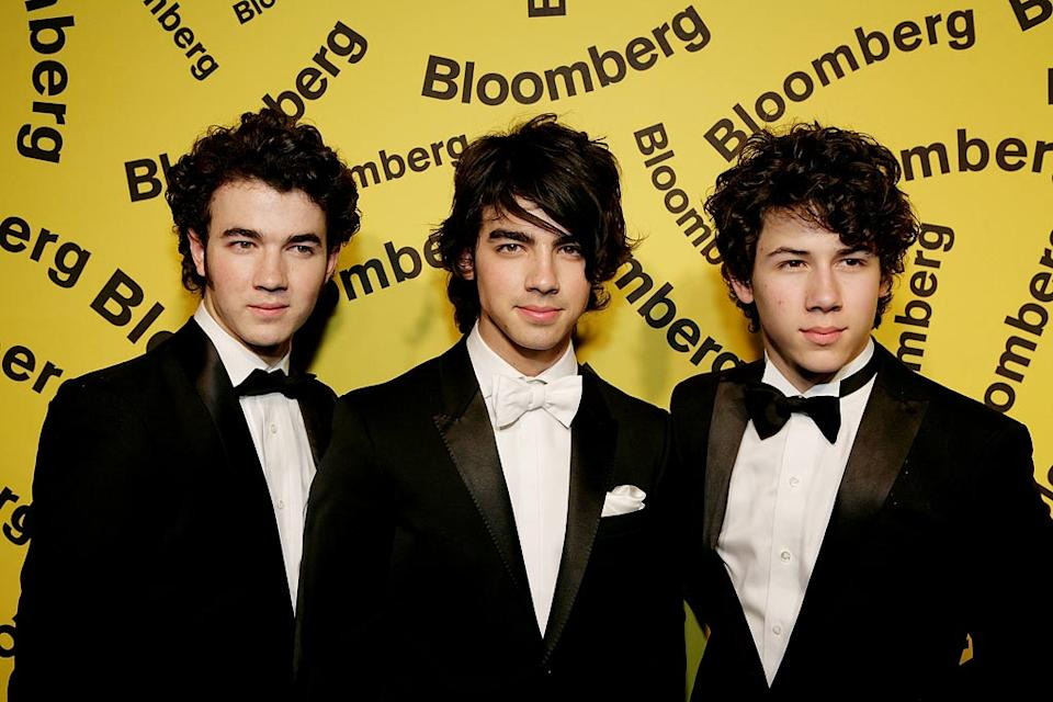 The Jonas Brothers, (l to r) Kevin, Joe, and Nick arrive for the after-party hosted by Bloomberg following the White House Correspondents' Association Dinner on April 26, 2008 in Washington, D.C.