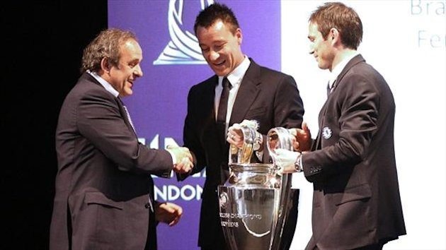 John Terry, centre, said handing back the trophy has made him more determined to keep Chelsea in the top four this season