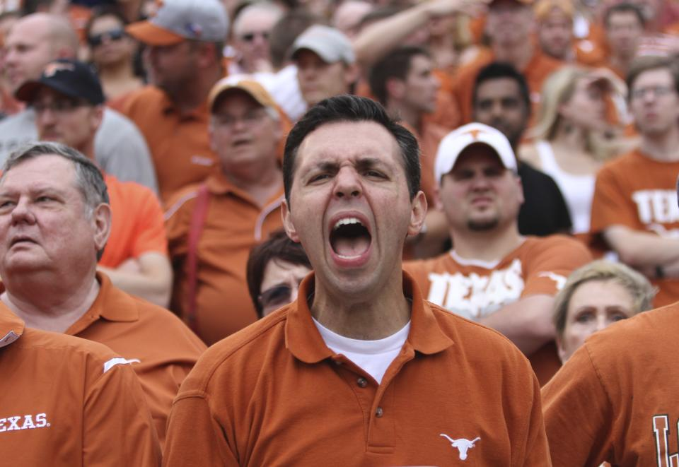 A Texas fan yells during the first half of an NCAA college football game against Oklahoma at the Cotton Bowl Saturday, Oct. 13, 2012, in Dallas. (AP Photo/Michael Mulvey)