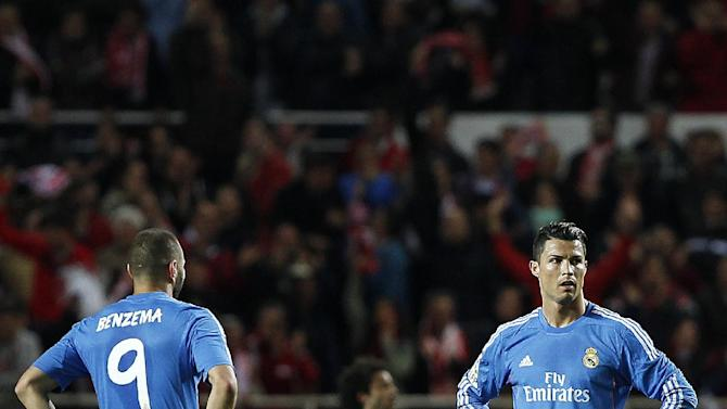 Real Madrid's Cristiano Ronaldo from Portugal, right, and Karim Benzema from France, left, react against Sevilla during their La Liga soccer match at the Ramon Sanchez Pizjuan stadium, in Seville, Spain on Wednesday, March 26, 2014