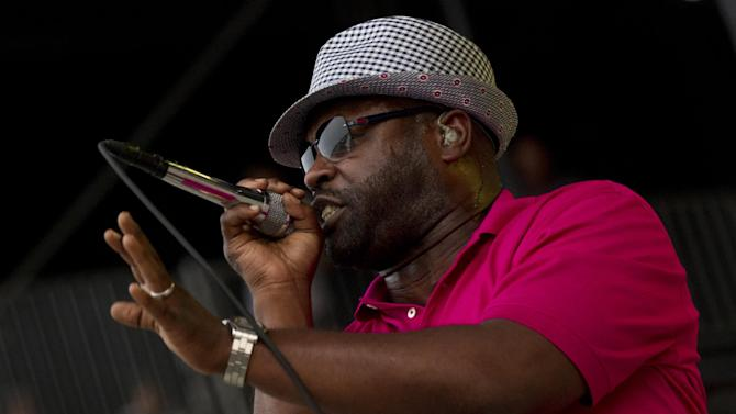 "FILE - In this June 9, 2012 file photo, Tariq ""Black Thought"" Trotter of The Roots performs during the Bonnaroo Music and Arts Festival in Manchester, Tenn. At the Austin City Limits Music Festival, about a third of the nearly 130 bands on a lineup that includes The Roots, the Red Hot Chili Peppers, the Black Keys and Jack White will have their sets broadcast on YouTube. That's a record for the three-day festival that starts Friday, Oct. 12, 2012. (AP Photo/Dave Martin, File)"