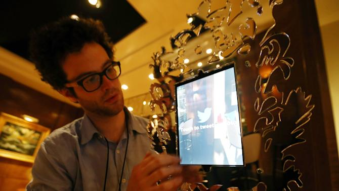 The Twitter Mirror that is going to be used during the Oscars is set up backstage at the 85th Academy Awards in Los Angeles, Friday, Feb. 22, 2013. The Academy Awards will be held Sunday, Feb. 24, 2013. As part of its push to attract younger viewers to the Oscars, the Academy of Motion Picture Arts and Sciences is working to make the show a two-screen experience by offering new camera perspectives and interactive features on its website. (Photo by Matt Sayles/Invision/AP)
