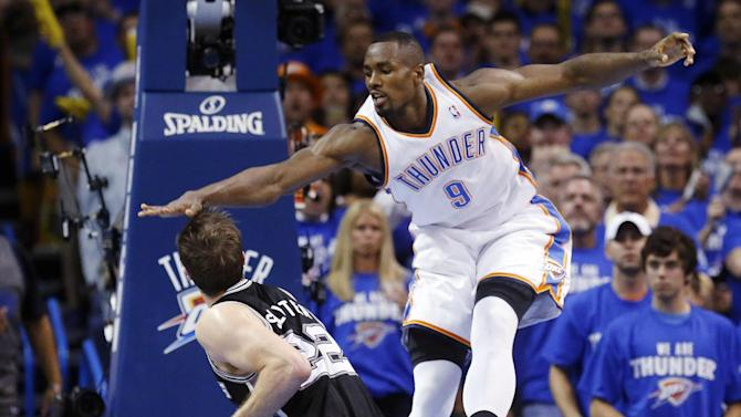 Oklahoma City Thunder forward Serge Ibaka (9) gets up to block a shot by San Antonio Spurs center Tiago Splitter (22) in the second quarter of Game 4 of the Western Conference finals NBA basketball playoff series in Oklahoma City, Tuesday, May 27, 2014