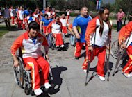 Chinese athletes prepare to depart for the London Paralympics 2012, in Beijing, August 21, 2012. China&#39;s new generation of athletes arrived in London with hopes of dominating the Paralympics, but officials are downplaying chances the streamlined team can match its mammoth 2008 medal haul