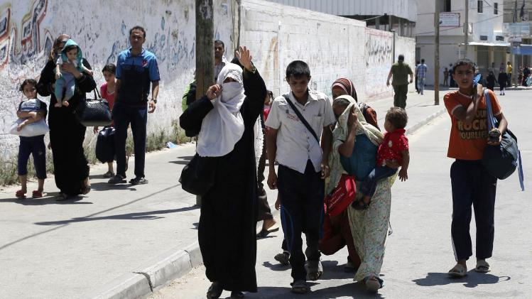 Palestinians flee from their houses during what witnesses said was heavy Israeli shelling in Rafah in the southern Gaza Strip