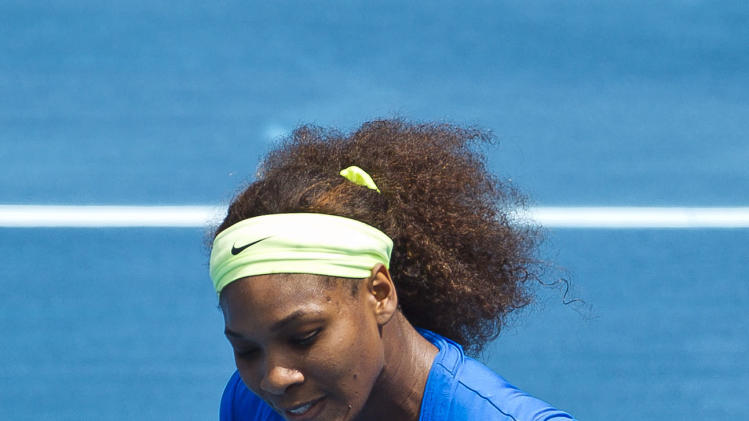 Serena Williams from the U.S. celebrates a point during the Madrid Open tennis tournament semifinal match against  Czech Republic's Lucie Hradecka, in Madrid, Saturday, May 12, 2012. (AP Photo/Daniel Ochoa de Olza)