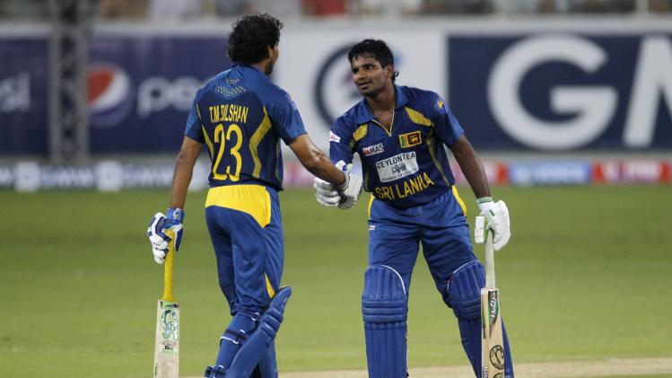 \Sri Lanka's Tillakaratne Dilshan congratulates Kusal Perera on reaching his half century in Dubai