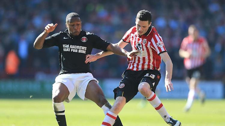 Sheffield United's Jamie Murphy, right, is brought down by Charlton Athletic's Callum Harriott during the FA Cup Sixth Round match at Bramall Lane, Sheffield, Sunday March 9, 2014. (AP Photo/Nick Potts, PA) UNITED KINGDOM OUT - NO SALES - NO ARCHIVES