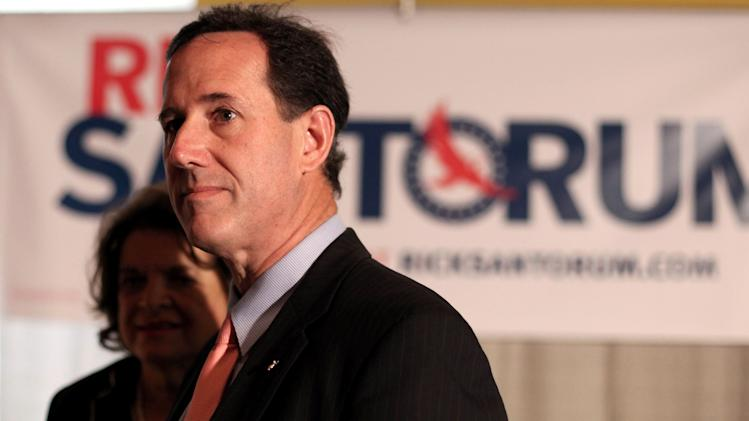 Republican presidential candidate, former Pennsylvania Sen. Rick Santorum attends a town meeting in San Juan, Puerto Rico, Wednesday March 14, 2012. (AP Photo/Dennis M. Rivera Pichardo)