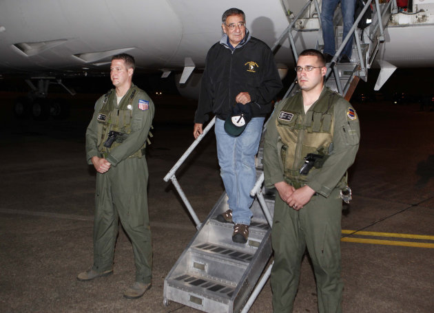 U.S. Defense Secretary Leon Panetta, center, steps off his jet after arriving at Yokota Air Base on the outskirts of Tokyo, Japan, Sunday, Sept. 16, 2012. Panetta is in Japan as part of his Asian tour which includes China and New Zealand. (AP Photo/Larry Downing, Pool)