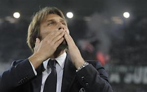 Juventus' coach Conte acknowledges the crowd before the Italian Serie A soccer match against Catania at the Juventus stadium in Turin