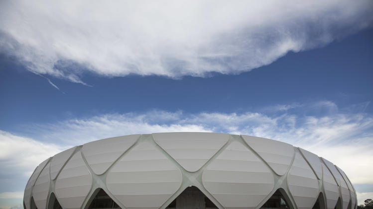 FILE - In this May 20, 2014 file photo, Arena da Amazonia stands in Manaus, Brazil. Once the World Cup leaves town, four gleaming stadiums that hosted massive crowds will echo softly as their owners struggle to find a use for them or even partially fill them. (AP Photo/Felipe Dana, File)