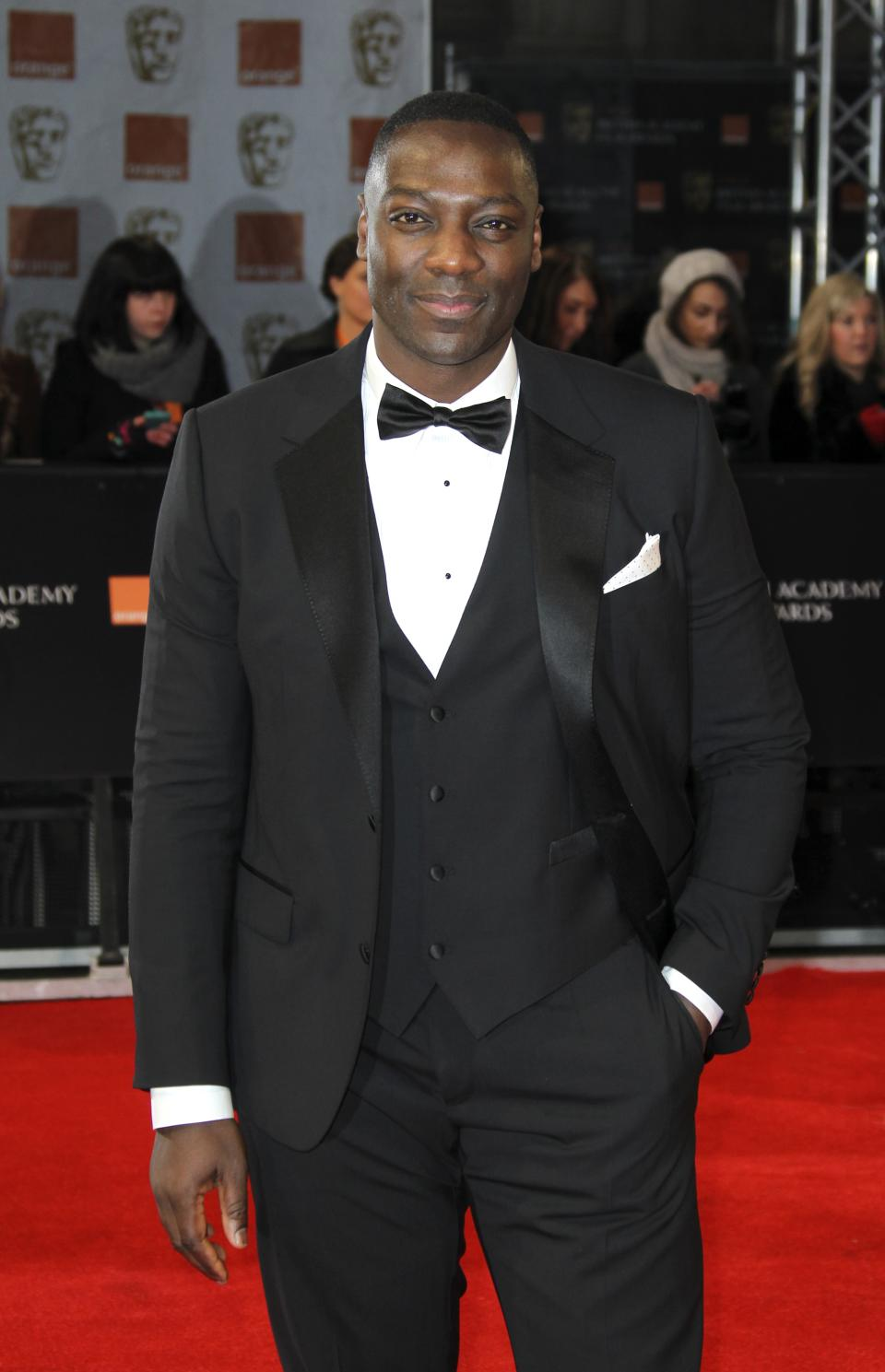 Actor Adewale Akinnuoye-Agbaje arrives for the BAFTA Film Awards 2012, at The Royal Opera House in London, Sunday, Feb. 12, 2012. (AP Photo/Joel Ryan)