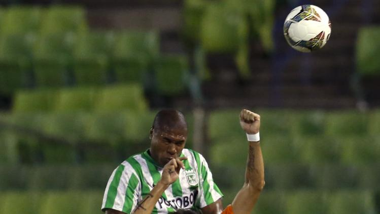 Henriquez of Colombia's Atletico Nacional challenges Iriberri of Venezuela's Deportivo La Guaira during their Copa Sudamericana soccer match in Caracas