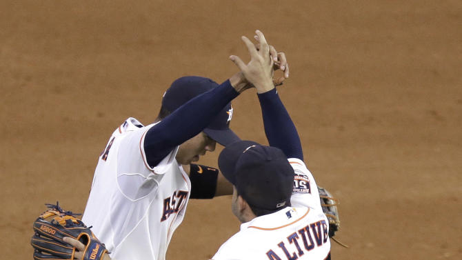 Houston Astros Jose Altuve (27) and Carlos Correa celebrate their 4-0 win over the Kansas City Royals in a baseball game Tuesday, June 30, 2015, in Houston. (AP Photo/Pat Sullivan)