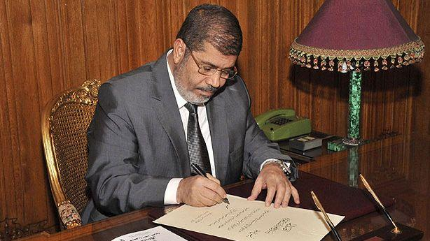 Egypt's President Signs the New Constitution into Law