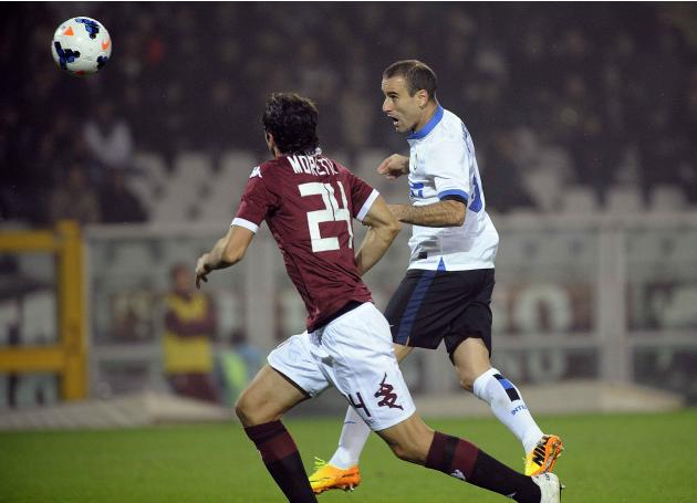 Inter Milan's Palacio scores against Torino during their Italian Serie A soccer match in Turin