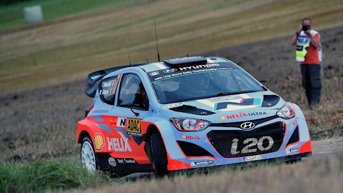 Belgium driver Thierry Neuville and his compatriot co-driver Nicolas Gilsoul steer their Hyundai i20 WRC as they compete during the FIA World Rally Championship of Germany in Trier, western Germany on August 22, 2014