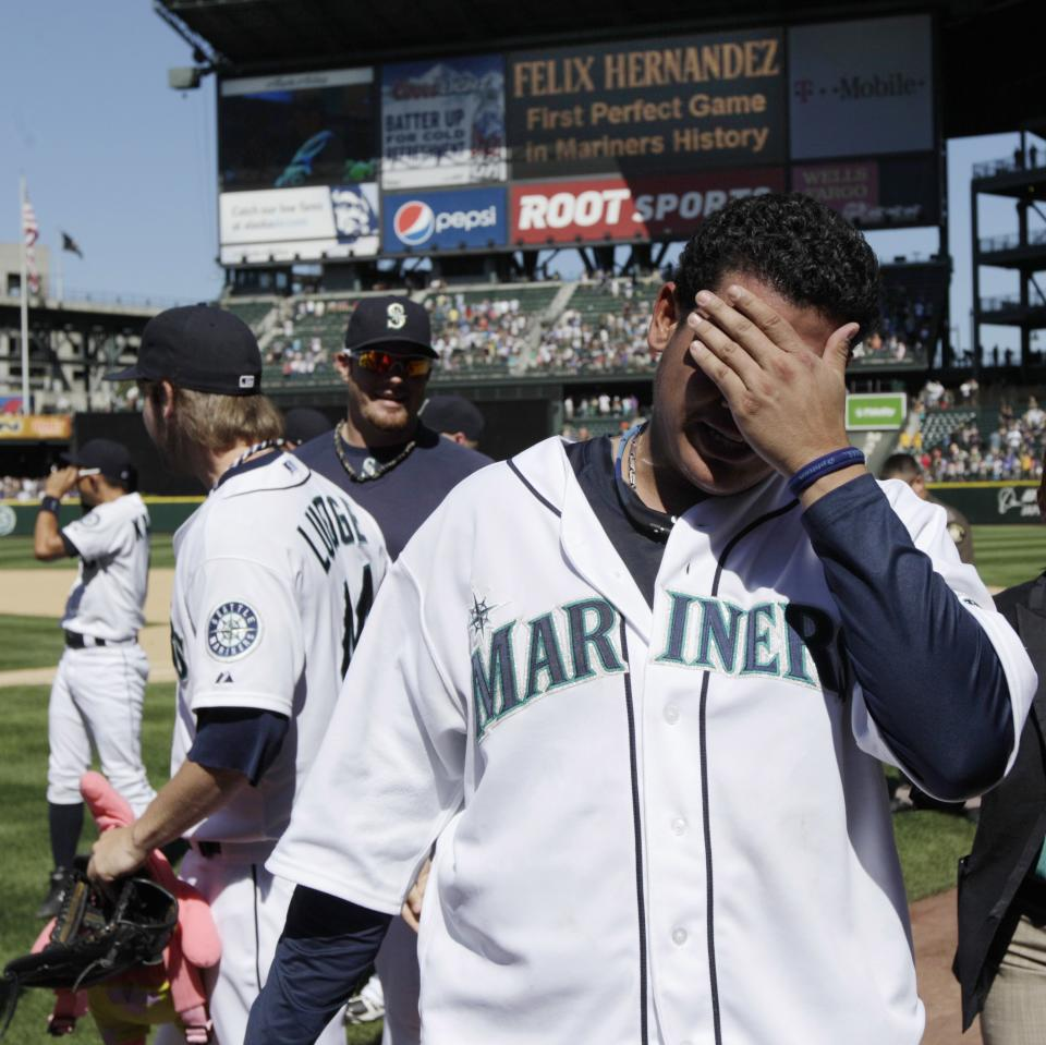 Seattle Mariners pitcher Felix Hernandez walks off the field after he threw a perfect game against the Tampa Bay Rays, Wednesday, Aug. 15, 2012, in Seattle. The Mariners defeated the Rays 1-0 in the baseball game. (AP Photo/Ted S. Warren)